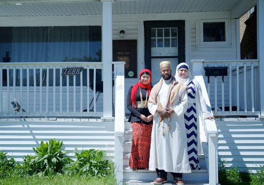 Abdur Rasheed Vanzant, 52, of Detroit with his wife Taqwa Vanzant, right, and daughter Shakeelah Vanzant, 24, standing in front of one of the completed houses on Waverly Street on Friday, May 22, 2015 in Detroit. (Photo: Salwan Georges Special to the Detroit Free Press)